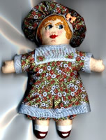 Mini cloth and embroidered doll 5 inches tall