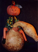 Cloth jointed doll pumpkin dude rides a gourd