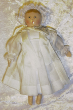 Tiny Columbian doll 9c in white dress