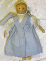 Small columbian doll 12c in blue checked dress