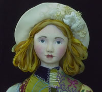 close up of embroidered cloth dolls face